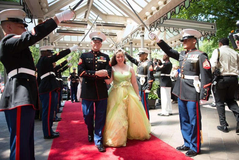 Marines from Marine Corps Base Quantico, Virginia welcomed and escorted each student down the red carpet and through the arch of Marine Corps noncommissioned officer swords at the 9th Annual National Capital Area A Cinderella Ball here, June 8, 2014. The Marines have played a part in A Cinderella Ball since it's inauguration in 2006.