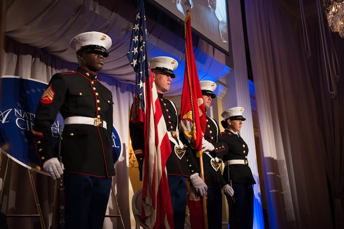 Marines from Marine Corps Base Quantico, Va. present the colors during the Pledge of Allegiance at the 9th Annual National Capital Area A Cinderella Ball here, June 8, 2014. The Marines have played a part in A Cinderella Ball since it's inauguration in 2006.