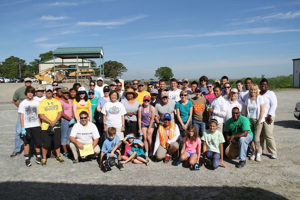 More than 70 volunteers participated in this year's Clean the Bay Day with the Norfolk District, U.S. Army Corps of Engineers. The location: the Craney Island Dredged Material Management Area here June 7, 2014. Volunteers from Williamsburg, James City County, Yorktown, Newport News, Poquoson, Hampton, Norfolk, Virginia Beach and Plymouth, Minnesota participated. Organizations represented included not only the Norfolk District but also members from Lafayette, Woodside, I.C. Norcom and Churchland High Schools, Girls Scout Troup 1381, Bayside Area Boy Scouts, Boy Scout Troup 6, Norfolk State University, Old Dominion University, Army, Navy, U.S. Coast Guard, the Society of Military Engineers and other organizations not captured.  A total of 68 bags of trash - 1,410 pounds of bagged trash and approximately 590 pounds of bulk non-bagged items – were collected. The most unusual items included a sledge hammer, a dog carcass, a kayak paddle, one dead turtle, a respirator, an arrow and one big red ball. The majority of debris was cigarette butts, plastic bottles and Styrofoam from buoys.