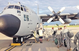 Soldiers of the 1st Inf. Div. begin loading into a C-130 as they depart the British Brize Norton Royal Air Force Base June 2 in Oxford, England. The Soldiers flew the final leg of their five-flight journey to France to help commemorate the 70th anniversary of D-Day landings in Normandy, France. The 1st Inf. Div. Soldiers will participate in more than 20 ceremonies celebrating the sacrifices made that day in 1944.
