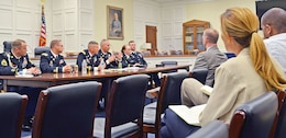 Maj. Joey L. Errington, executive officer, 2nd ABCT, center left at table, responds to a question from a congressional staff member May 27 in a hearing room in the Rayburn House Office Building.