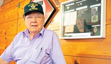 Jim Sharp, Manhattan, Kan., poses with memorabilia he kept during his time serving in WWII and after during special duty as a sergeant of the guard for the Nuremburg War Crimes trials.