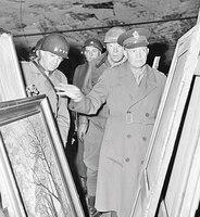 Gen. Dwight D. Eisenhower, Supreme Allied commander, accompanied by Gen. Omar N. Bradley and Lt. Gen. George S. Patton Jr., inspects art treasures stolen by Germans and hidden in salt mine in Germany April 12, 1945.