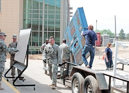 Soldiers with the 1st Bn., 5th FA Regt. help FRMS staff move from the old school to the new school to ensure construction could continue without delay. About 53 Soldiers helped with the move, alongside contractors for USD 475.