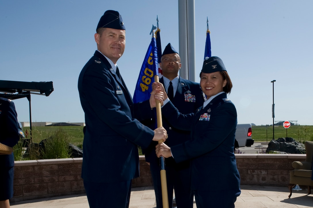 Col. Dan Wright, 460th Space Wing commander, presents the 460th Mission Support Group flag to Col. Rose Jourdan, 460th MSG commander, to symbolize her assumption of command June 10, 2014, at the 460th SW Headquarters on Buckley Air Force Base, Colo. During the ceremony, Jourdan assumed command of the 460th MSG from Col. Robert Uemura, who served as the commander since June 2012. (U.S. Air Force photo by Senior Airman Phillip Houk/Released)