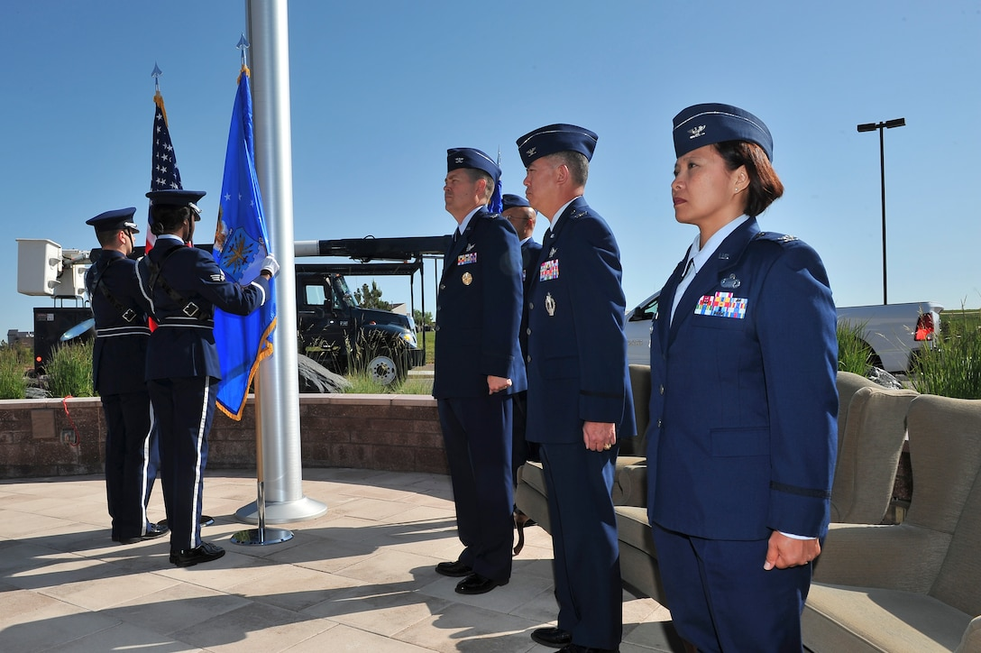 The Mile High Honor Guard presents the colors during the 460th Mission Support Group change of command ceremony June 10, 2014, at the 460th Space Wing Headquarters on Buckley Air Force Base, Colo. During the ceremony, Col. Rose Jourdan, right, assumed command of the 460th MSG from Col. Robert Uemura. (U.S. Air Force photo by Senior Airman Phillip Houk/Released)