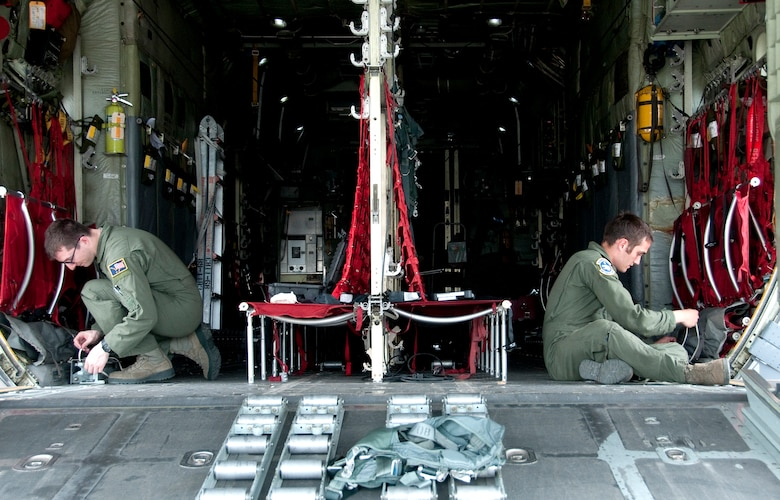 Crew members from the 144th Airlift Squadron set up a C-130 Hercules on Joint Base Elmendorf-Richardson, Alaska, to accommodate paratroopers of the 4th Brigade Combat Team (Airborne), 25th Infantry Division as part of a Joint Forcible Entry Exercise on June 7, 2014. The six-day exercise involved over 1,500 personnel including active duty Army, Air Force and the Air National Guard. (U.S. Air National Guard photo by Staff Sgt. N. Alicia Halla/ Released)