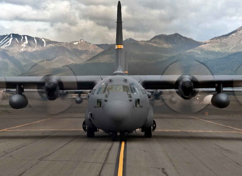 An Alaska Air National Guard C-130 Hercules prepares to take off from Joint Base Elmendorf-Richardson, Alaska, as part of a six-day Joint Forcible Entry Exercise on June 7, 2014. The JFEX was a joint effort between active duty Army, Air Force and Air National Guard units from Alaska, Washington and Guam. (Air Force photo by Staff Sgt. William Banton/ Released)