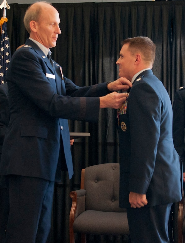 U.S. Air Force Brig.Gen. William N. Reddel, III, Adjutant General of New Hampshire, awards the N.H. National Guard Distinguished Service medal to U.S. Air Force Lt. Col. J. Scot Heathman, Commander, 64th Air Refueling Squadron, Pease Air National Guard Base, N.H., during a change of command ceremony held at Pease, June 8, 2014.  Heathman relenquished command to U.S. Air Force Lt. Col. Bradley Stevens during the ceremony.