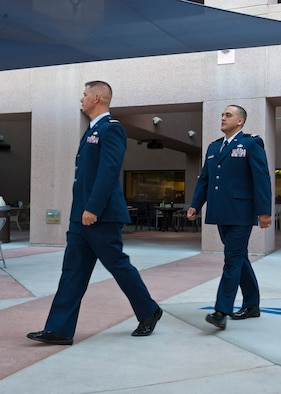 U.S Air Force 1st Lt. Kevin Stuessy (left), and 1st Lt. Christopher Gomez, Interservice Physician Assistant Program students, enter at the beginning of their graduation ceremony at the Mike O'Callaghan Federal Medical Center, June 6, 2014, at Nellis Air Force Base, Nev. Graduates of the IPAP are commissioned as First Lieutenants, if they are not already officers, and receive a Master Physician Assistant Studies diploma from the program's affiliate, the University of Nebraska Medicine Center. (U.S. Air Force photo by Airman 1st Class Thomas Spangler)