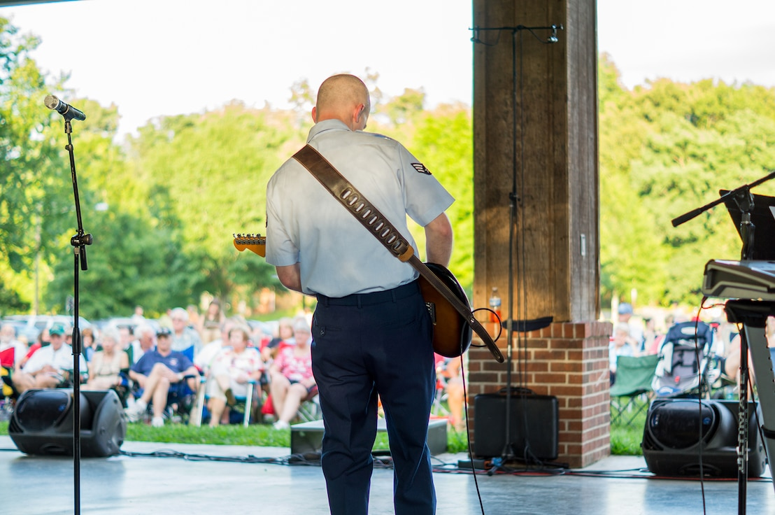 The crowd in Norris, TN enjoys Senior Airman Andrew Thompson's solo with Space A, our small rock band