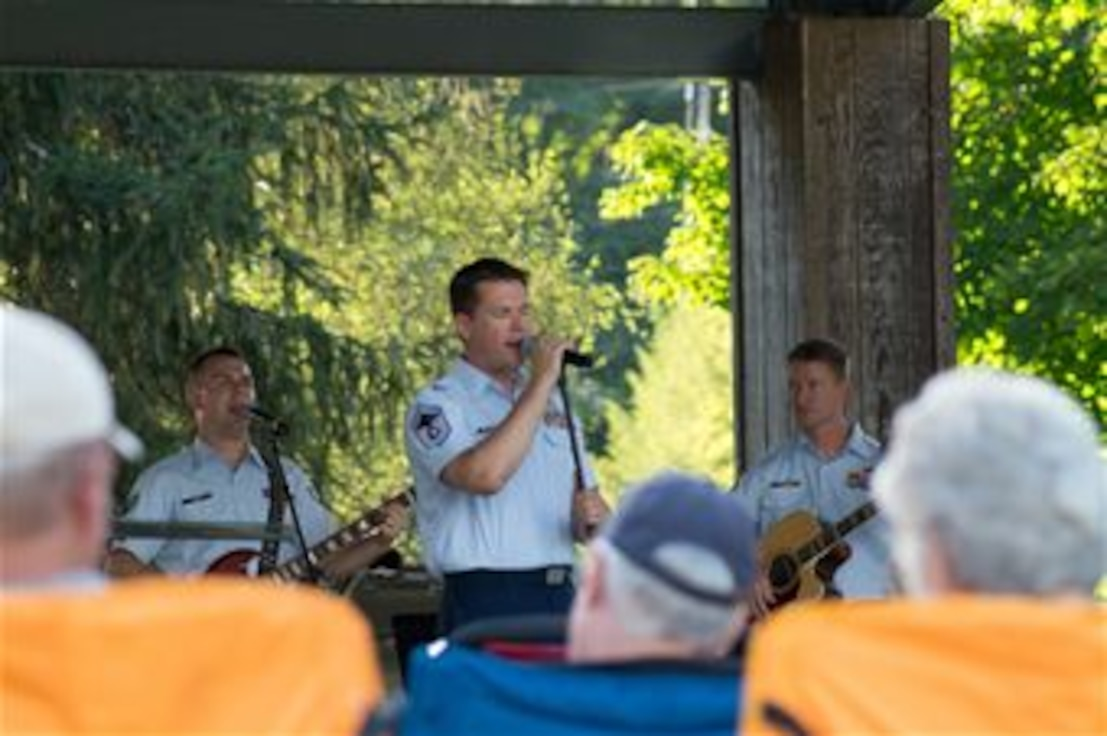 Our band's Superintendent, Senior Master Sergeant Brent Whitaker, sings with Space A, our small rock band