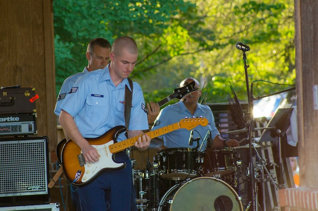 Senior Airman Andrew Thompson plays a guitar solo with Space A, our small rock band