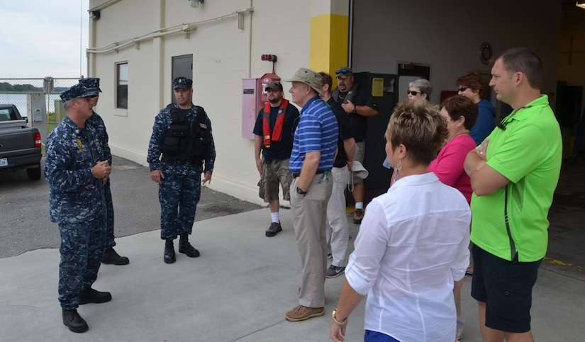 Lieutenant Commander Sean McMichael, 628th Security Forces Squadron Deputy Defense Force commander (left), welcomes Joint Base Charleston Honorary Commanders as they prepare to get underway onboard the 628th SFS patrol boats June 6, 2014, at JB Charleston – Weapons Station. The Honorary Commanders program was developed to encourage an exchange of ideas, experiences, and friendship between key members of the local civilian community and the Charleston military community.  The program provides a unique opportunity for members of the Charleston area to shadow commanders of groups, squadrons and tenant units at JB Charleston. (U.S. Air Force photo/Eric Sesit)