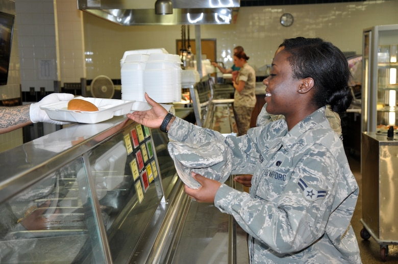 GOODFELLOW AIR FORCE BASE, Texas – Airman 1st Class Jebree M. Hinton, 17th Training Wing Legal Office Military Justice paralegal, receives her grilled sandwich at the Cressman Dining Facility May 6. Hinton and some other permanent party personnel as well as students already have meals deducted from their pay, so they do not need to worry about paying at the checkout. (U.S. Air Force photo/ Senior Airman Joshua Edwards)