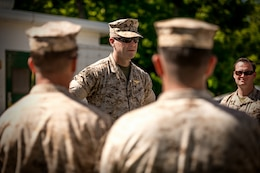 A Marine at Quantico addresses employees from the Program and Resources Office at Headquarters Marine Corps. Employees from P&R visited Quantico June 6, to better understand how their work impacts Marines in the fleet.
