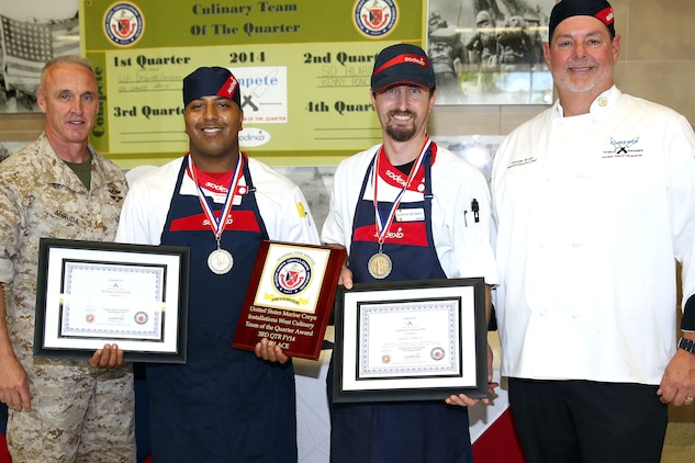 CAMP PENDLETON, Calif. - Three teams of two competed for the title of the Culinary Team of the Quarter at the 31 Area Mess Hall on Edson Range here June 11. The winners for this quarter were Team 1, Dustin Delmar and Anthony Stewart who work at the 33 Area Mess Hall here.  The competition is a two-day event.  On the first day, 12 teams competed in a book test and a Jeopardy-style quiz. Only four teams qualified to move on to the cooking portion of the competition the following day.  The theme of the cooking competition this quarter was barbeque and each team was expected to make a protein dish using chicken or pork, cornbread and a salad. This quarter the competition included 45 minutes of assistance to each team from guest chef Rahm Fama.  This competition is used not only as an training tool, but also to build camaraderie among the food service community, said Donovan Brown, the Marine Corps Installations West Regional executive chef.  From Left to Right: Col. Jeff Arruda, Anthony Stewart, Dustin Delmar, Donovan Brown.