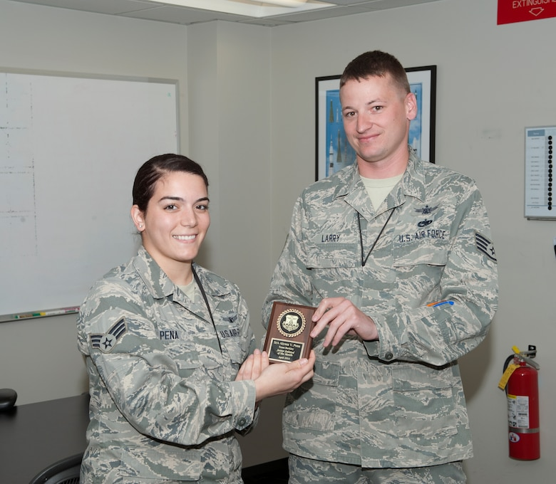 Senior Airman Alyssa Pena, 460th Operations Group, is awarded the Junior Enlisted of the Month award. The JEoM award is given to the most deserving Airmen who have not only shown hard work, supreme leadership and dedication to their job, but also put forth significant effort into bettering themselves and the community. (U.S. Air Force photo by Airman 1st Class Samantha Saulsbury/Released)