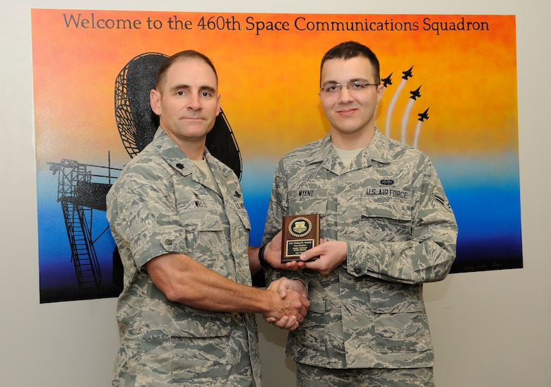 Airman 1st Class Dylan Wyant, 460th Space Communication Squadron, is awarded the Junior Enlisted of the Month award. The JEoM award is given to the most deserving Airmen who have not only shown hard work, supreme leadership and dedication to their job, but also put forth significant effort into bettering themselves and the community. (U.S. Air Force photo by Airman 1st Class Samantha Saulsbury/Released)