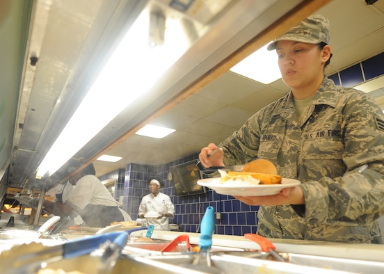 ALTUS AIR FORCE BASE, Okla. – U.S. Air Force Senior Airman Erika Aburto, 97th Force Support Squadron food service technician, prepares a plate of food at the Solar Inn Dining Facility June 6, 2014. The dining facility is an essential part of the Altus AFB mission, replenishing Airmen with four meals a day to keep the mission going of forging combat mobility forces and deploying Airmen warriors.   (U.S. Air Force photo by Senior Airman Levin Boland/Released)