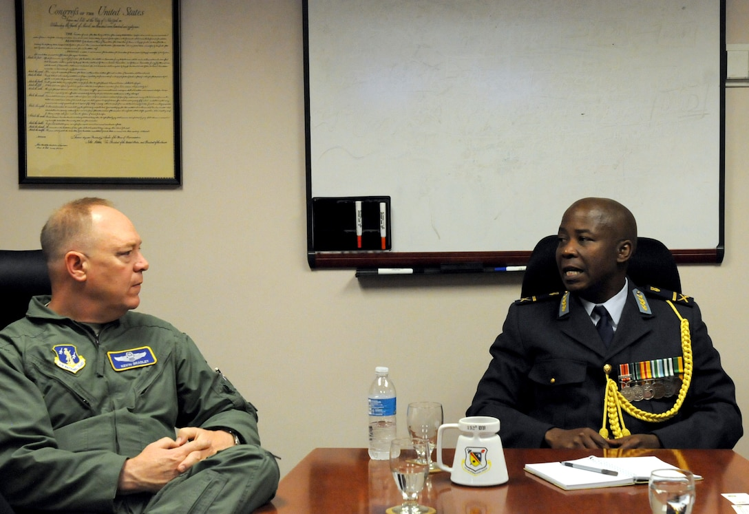 Brig. Gen. Kevin W. Bradley, Assistant Adjutant General for Air (left), speaks with Brig. Gen. Mashoro Abel Phala, Defense Attache with the South African Embassy (right), during his visit to the 152nd Air Operations Group. Gen. Phala visited for the purpose of strengthening relationships through the State Partnership Program. (New York Air National Guard Photo By Senior Airman Duane Morgan)