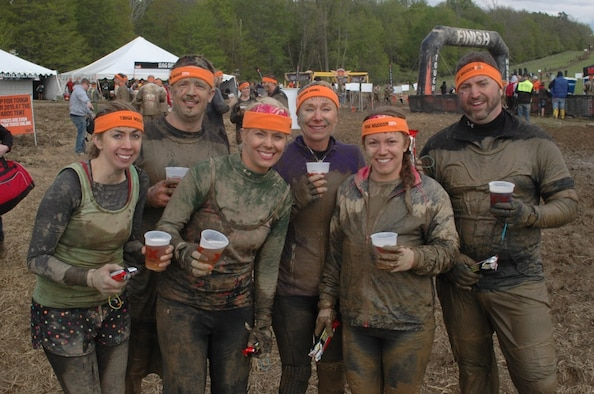 The 179th Airlift Wing's Medical Dental Group (MDG) Mudders worked together to complete a challenging Tough Mudder course, May, 2014.  Pictured left to right Tech. Sgt. Sandi Gurnsey, Maj. Terry Walker, Tech. Sgt. Joeleen Mellars, Lt. Col. Sherri Campbell, Staff Sgt. Natasha Grau, and Capt. Ryan Bogart.(Courtesy Photo by Maj Terry Walker\Released)