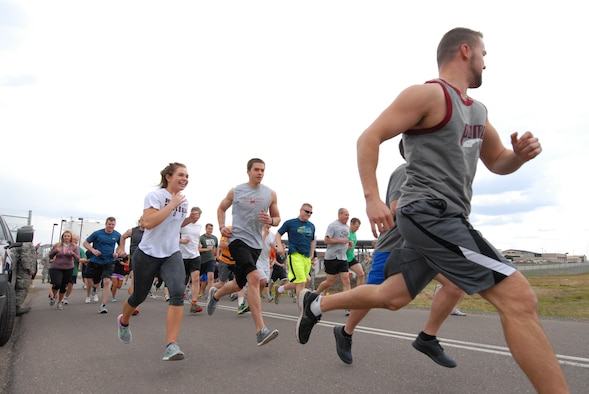 148th Fighter Wing members take off from the starting line while participating in the Fifth Annual 5K Meatball Run, 148th Fighter Wing, Duluth, Minn., May 18, 2014.  Most of the proceeds from the event go to support a local food bank in the Duluth, Minn. area, plus it gets members into the fitness frame of mind after a long winter.  (U.S. Air National Guard photo by Staff Sgt. Donald Acton/Released)