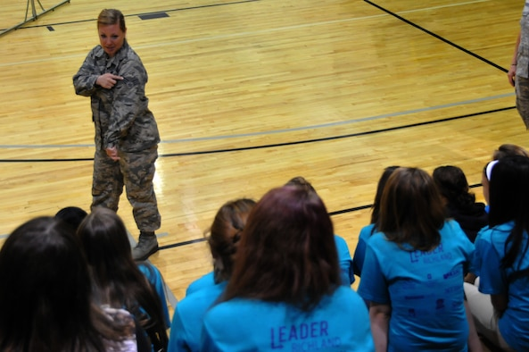 Senior Airman Casey Vaughn speaks to girls about her experience in the Air National Guard as the 179th Airlift Wing and 200th RED HORSE Det. 1 particpate in the Leader Richland event at Ohio State Mansfield/North Central State College campus, Mansfield, OH, May 15, 2014. The program is by the Richland Community Development Group and aims to inspire 7th and 8th graders to reach their full potential as future community leaders. (U.S. Air National Guard photo by Technical Sergeant Joe Harwood/Released)