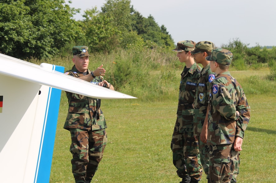 Civil Air Patrol Lt. Col. Chad Morris, Spangdahlem Cadet Squadron commander, instructs Cadets Sean Cannon, Andrew Cannon and Teagan Thomas before flying in an ASK-21 Glider during a Flight Orientation Program June 8, 2014. The glider was launched into the air in about three seconds using a winch system. (Courtesy photo/released)