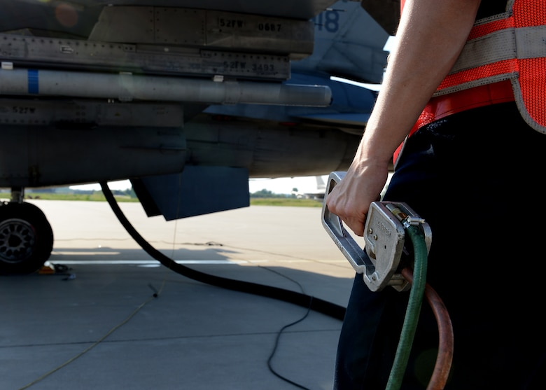 U.S. Air Force Senior Airman Katherine Meakins, 480th Fighter Squadron crew chief, Spangdahlem Air Base, Germany, pumps fuel into a returning U.S. Air Force F-16 Fighting Falcon fighter aircraft at Lask Air Base, Poland, June 9, 2014. There are four Polish Air Force Oshkosh R-11 fuel trucks at Lask Air Base that support refueling operations for U.S. and Polish aircraft participating in Exercise EAGLE TALON, BALTOPS 14 and U.S. Aviation Detachment Rotation 14-3 activities. The trucks pump approximately 600 gallons of fuel per minute. This is the first time hot pit refueling has been done in Poland by U.S. Forces. (U.S. Air Force photo by Airman 1st Class Kyle Gese/Released)