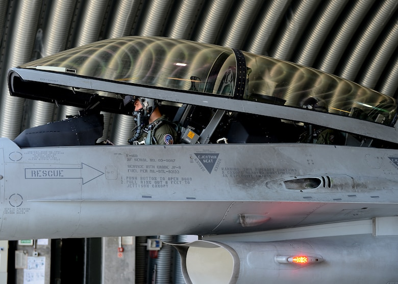 Polish air force 1st Lt. Tomasz Grzybowski, F-16 Fighting Falcon fighter aircraft pilot, and Polish air force 2nd Lt. Komrad Zwolinski, TS-11 and PZL-130 pilot, closes the canopy of the aircraft for departure at Lask Air Base, Poland, June 10, 2014. Grzybowski and Zwolinski participated in Exercise EAGLE TALON, a Polish-led combined exercise, with NATO partners to increase interoperability and familiarize themselves with foreign procedures. (U.S. Air Force photo by Airman 1st Class Kyle Gese/Released)