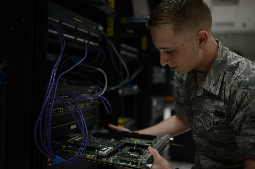 U.S. Air Force Airman 1st Class Zachery Cook, 52nd Communications Squadron cyber system operations technician from Cleveland, removes a computer component from a training lab at Spangdahlem Air Base, Germany, June 10, 2014. Airmen use the training lab to conduct training and tests on a stand-alone network, so any training errors will not affect Spangdahlem's live network. (U.S. Air Force photo by Senior Airman Gustavo Castillo/Released)