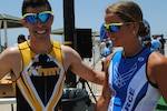 The two first-place finishers, Army Capt. Nick Vandam for the men and Air Force 2nd Lt. Samantha Morrison for the women, relax after the triathlon.