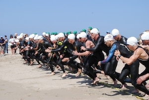Male triathletes from the U.S. Navy, Army, Air Force and Marine Corps take off on the first leg of the 2014 Armed Forces Triathlon Championship — a one-mile ocean swim — Saturday, May 31, at Naval Base Ventura County (NBVC) Point Mugu.