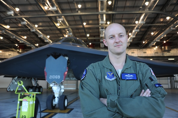 Royal Air Force Flight Lieutenant Ian Hart stands in front of a B-2 Spirit June 10, 2014, at RAF Fairford, England. Hart is part of a United States - United Kingdom exchange program, where he trains alongside American B-2 pilots. Since 2012, he has been flying the B-2 as part of the 13th Bomb Squadron, Whiteman Air Force Base, Mo. Hart is a GR4 Tornado pilot (U.S. Air Force photo/Staff Sgt. Nick Wilson)