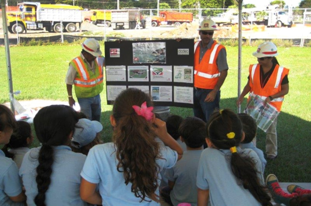 Antilles Elementary School students listen as U.S. Army Corps of Engineers representatives describe their new school, currently under construction at Fort Buchanan, Puerto Rico.