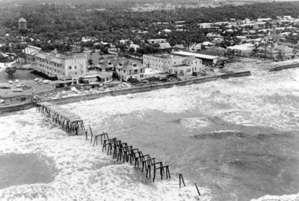 The Atlantic Beach Hotel and pier were devastated by the impacts of Hurricane Dora. The storm lingered off the Atlantic coast for nearly 24 hours, allowing winds to drive the storm surge to a point 10 feet above normal tide.