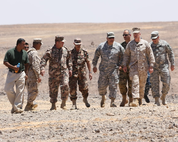 PETRA, Jordan (June 1, 2014) -- Brigadier Gen. Gregg Olson and Jordanian Armed Forces Brig. Gen.  Ali Al-Domi, Commanding General, 99th Armoured Brigade,  greet U.S. Army Maj. Gen. Robert Catalanotti, U.S. Central Command director of Exercises and Training Directorate, as he arrives to review a range in support of Eager Lion 2014 at a base near Petra, Jordan,  June 1 Eager Lion is a recurring, multinational exercise designed to strengthen military-to-military relationships, increase interoperability between partner nations and enhance regional security and stability.   (U.S. Marine Corps photo by; Sgt James A. Hall, CE MARFOR CENTCOM (FWD) Combat Camera/Released)