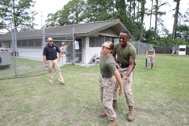 Marine Corps Recruit Depot Parris Island's Auxiliary Security Force began their Oleoresin Capsicum Contamination training at the Provost Marshal's Office aboard Marine Corps Air Station Beaufort, June 3. The Provost Marshal's Office aboard the Air Station provides law enforcement, investigative, and security services to MCAS Beaufort, Marine Corps Recruit Depot Parris Island and Naval Hospital Beaufort, S.C.