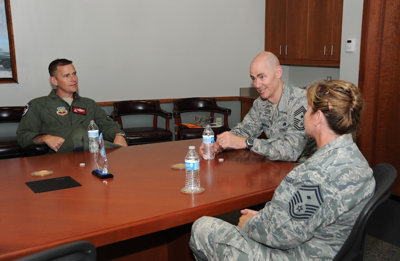 Col. Rick Wedan, 142nd Fighter Wing Commander, left, meets with Ronald C. Anderson Jr., Command Chief Master Sgt., 1st Air Force, center, and Senior Master Sgt. Lorene Kitzmiller, the First Sgt. for 1st Air Force, right, following a base tour of the Portland Air National Guard Base, Ore., June 10, 2014. Anderson and Kitzmiller spent the day meeting Airmen and getting feedback as they toured various areas of the wing. (Air National Guard photo by Tech. Sgt. John Hughel, 142nd Fighter Wing Public Affairs/Released)