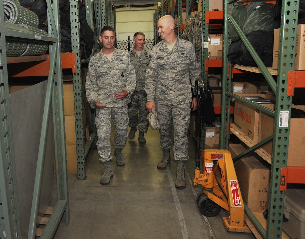 Staff Sgt. Matthew Ritchie, left, assigned to the 142nd Security Forces Squadron, walks Ronald C. Anderson Jr., Command Chief Master Sgt., 1st Air Force, right, thought the supply area used by the Security Forces Airmen during his visit to the Portland Air National Guard Base, Ore., June 10, 2014. (Air National Guard photo by Tech. Sgt. John Hughel, 142nd Fighter Wing Public Affairs/Released)