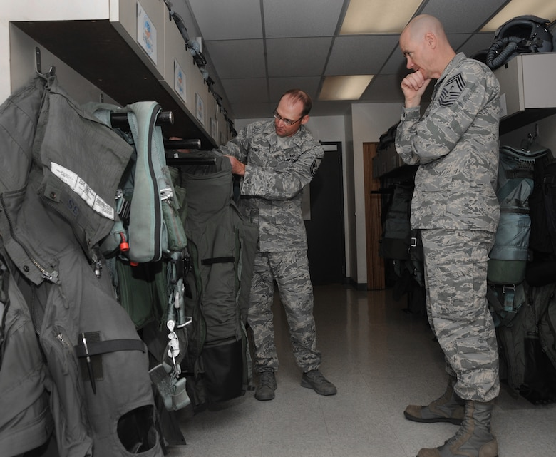 Ronald C. Anderson Jr., Command Chief Master Sgt., 1st Air Force, right, inspects new G-Suits with Master Sgt. Mike Larner, a flight equipment specialist, left, during his tour of the Portland Air National Guard Base, Ore., June 10, 2014. (Air National Guard photo by Tech. Sgt. John Hughel, 142nd Fighter Wing Public Affairs/Released)