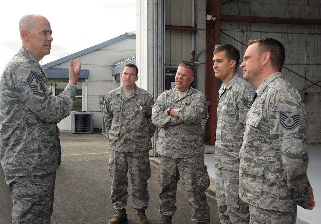 Ronald C. Anderson Jr., Command Chief Master Sgt., 1st Air Force, left, meets with several maintenance Airmen of the 142nd Fighter Wing during his tour of the Portland Air National Guard Base, Ore., June 10, 2014. (Air National Guard photo by Tech. Sgt. John Hughel, 142nd Fighter Wing Public Affairs/Released)