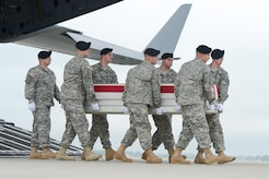 A U.S. Army carry team transfers the remains of Cpl. Justin R. Clouse of Sprague, Wash., during a dignified transfer June 12, 2014, at Dover Air Force Base, Del. Clouse was assigned to the 2nd Battalion, 12th Infantry Regiment, 4th Infantry Brigade Combat Team, 4th Infantry Division, Fort Carson, Colo. (U.S. Air Force photo/Greg L. Davis)