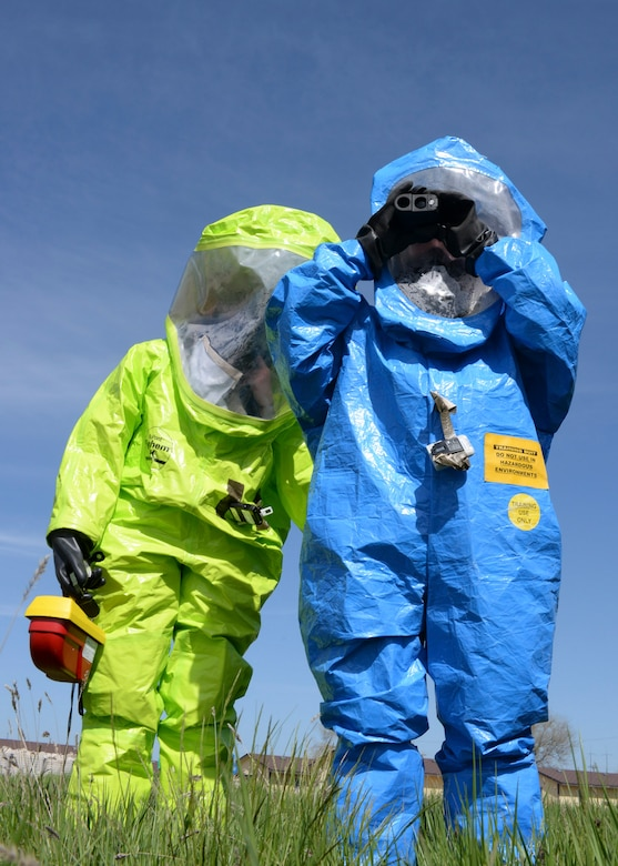 Airman 1st Class Ronald Reynolds, 28th Civil Engineer Squadron emergency management technician, and Staff Sgt. Kathleen Couillard, 28th Medical Operations Squadron bioenvironmental technician, test air quality during a simulated radiation scenario as part of an Integrated Base Emergency Response Capabilities Training at Ellsworth Air Force Base, S.D., May 22, 2014. The test determines the type of respiratory protection emergency response teams need in order to safely operate in a compromised environment. (U.S. Air Force photo by Senior Airman Anania Tekurio/Released)