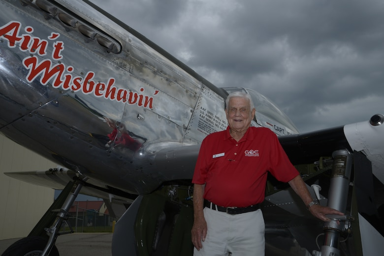"Col. Clarence ""Bud"" Anderson (retired) stands in front of a P-51 Mustang  during the Gathering of Eagles annual event at Maxwell Air Force Base, June 6, 2014. Anderson, who is a triple Ace from WWII, flew a P-51 Mustang during the allied invasion of Normandy 70 years ago to the day, known as D-Day. (U.S. Air Force photo by Staff Sgt. Gregory Brook)"