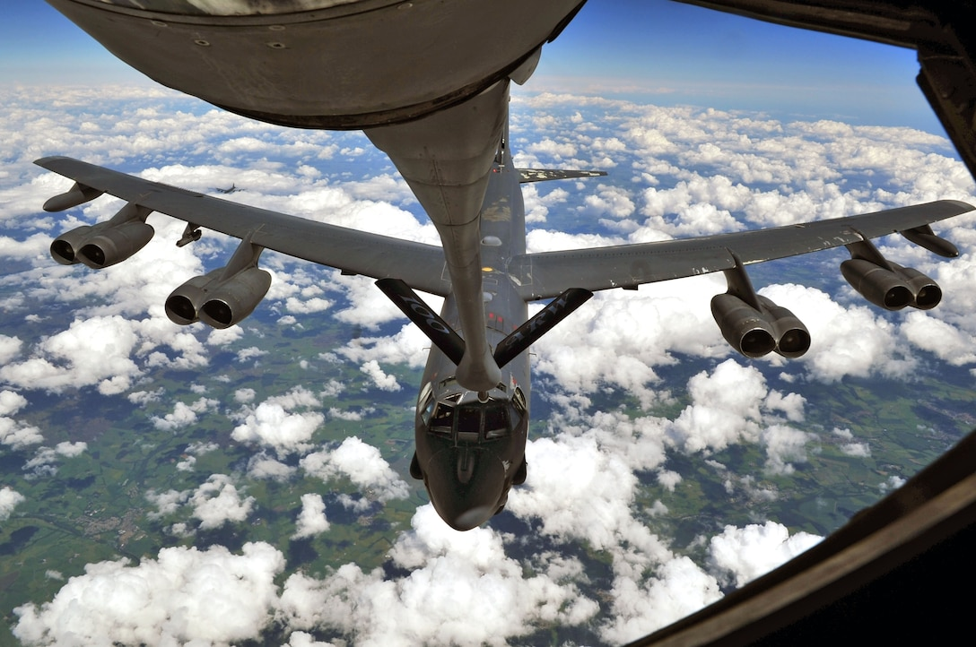 A B-52 Stratofortress deployed to RAF Fairford, England from Barksdale Air Force Base, La., performs air refueling with a KC-135 Stratotanker from RAF Mildenhall, England June 11, 2014, over the United Kingdom. The B-52 fuel tank can hold up to 312,197pounds of fuel during the refueling mission. (U.S. Air Force photo by Senior Airman Christine Griffiths/Released)