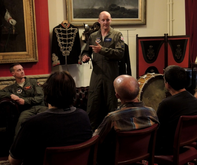 Royal Air Force Flight Lieutenant Ian Hart, GR4 Tornado pilot, speaks with members of the Cirencester Air Group during a group meeting June 9, 2014 in Swindon, England. Hart, along with fellow B-2 and B-52 pilots, spoke about their training and experiences as Air Force pilots. Hart is currently participating in a specialized United Kingdom-United States exchange program, where he is assigned to the 13th Bomb Squadron, Whiteman Air Force Base, Missouri and accomplishes training alongside American B-2 pilots. (U.S. Air Force photo by Candy Knight/Released)