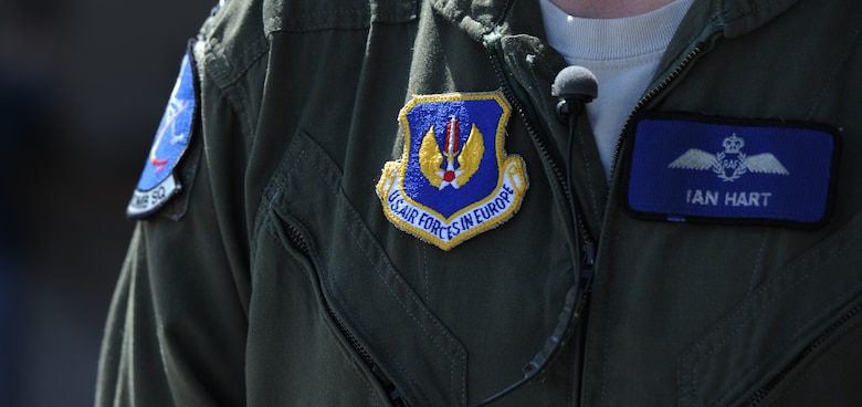 Royal Air Force Flight Lieutenant Ian Hart, GR4 Tornado pilot, wears a U.S. Air Forces in Europe patch on his flight suit to show he is part of the U.S. Air Force team, while participating in interoperability training RAF Fairford, England, June 10, 2014. Since 2012, he has been flying the B-2 as part of the 13th Bomb Squadron, Whiteman Air Force Base, Missouri. He has 11 years of aviation experience. (U.S. Air Force photo by Staff Sgt. Nick Wilson/Released)