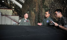 Lt. Col. Luke Lokowich, 5th Reconnaissance Squadron commander, and Republic of Korea air force Lt. Gen. Jae-Bock Park, ROK Air Force Operations Command commander, discuss the features of the U-2 Dragon Lady's wings during the general's immersion tour at Osan Air Base, ROK, June 11, 2014. Lokowich briefed Park on the capabilities of the airframe and showed him examples of the images U-2s are capable of capturing in flight. (U.S. Air Force photo/Airman 1st Class Ashley J .Thum)